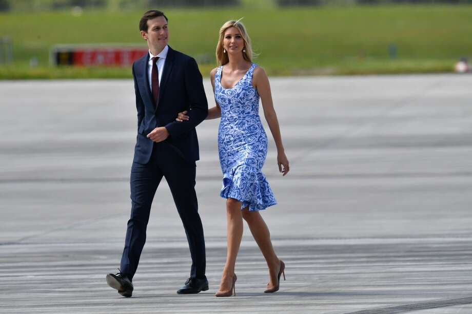 The daughter of US President Donald Trump Ivanka Trump (R) and her husband  White
