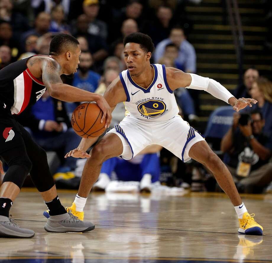 Patrick McCaw (0) defends against Damian Lillard (0) during the second half as the Golden State Warriors played the Portland Trail Blazers at Oracle Arena in Oakland, Calif., on Monday, December 11, 2017. Photo: Carlos Avila Gonzalez, The Chronicle