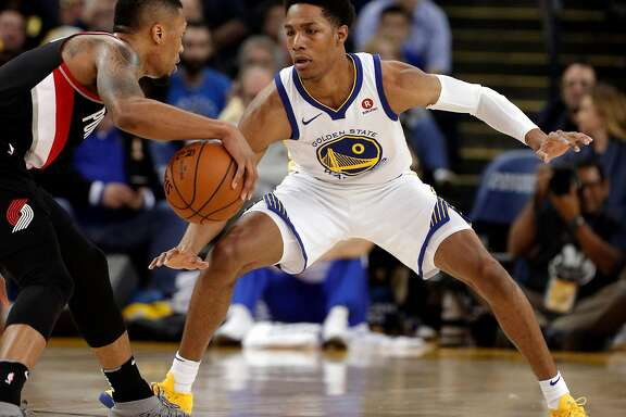 Patrick McCaw (0) defends against Damian Lillard (0) during the second half as the Golden State Warriors played the Portland Trail Blazers at Oracle Arena in Oakland, Calif., on Monday, December 11, 2017.