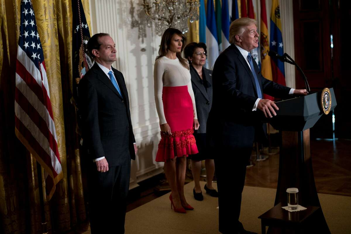 US Secretary of Labor R. Alexander Acosta (L), US First Lady Melania Trump (2L) and Jovita Carranza (2R), Treasurer of the United States, listen while US President Donald Trump speaks during a Hispanic Heritage Month event in the East Room of the White House October 6, 2017 in Washington, DC. President Trump invited over 200 Hispanic business, community, and faith leaders, and guests from across the country to join in the celebration of Hispanic Heritage Month. / AFP PHOTO / Brendan Smialowski (Photo credit should read BRENDAN SMIALOWSKI/AFP/Getty Images)