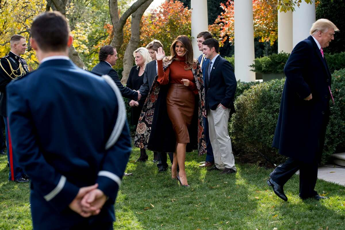 First Lady Melania Trump (C) waves after U.S. President Donald Trump (R) pardoned the Thanksgiving turkey Drumstick in the Rose Garden of the White House in Washington, D.C., on November 21, 2017.