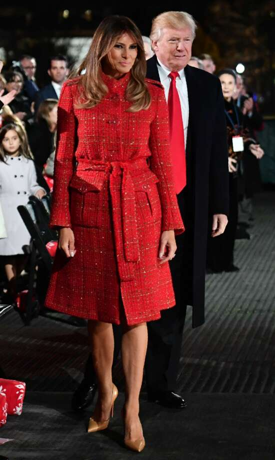 US President Donald Trump and First Lady Melania Trump walk to the stage during the 95th annual National Christmas Tree Lighting ceremony at the Ellipse in President's Park near the White House in Washington, D.C on November 30, 2017. Photo: NICHOLAS KAMM/AFP/Getty Images