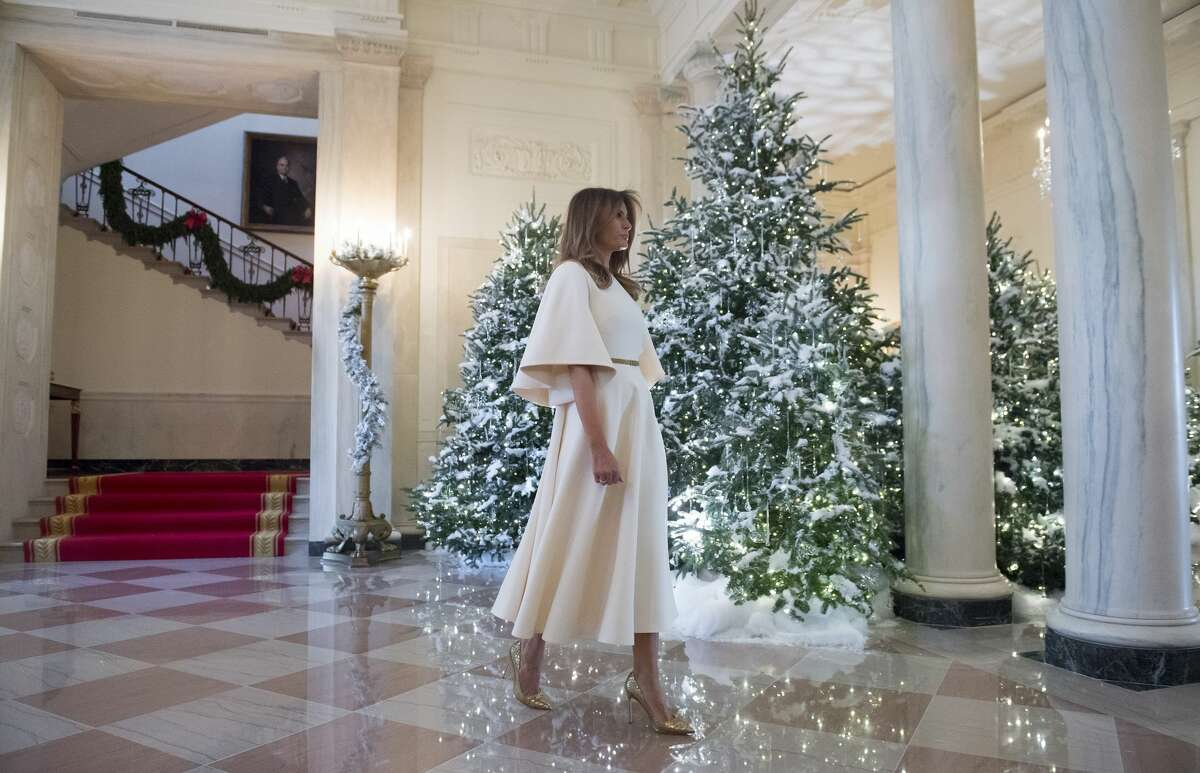 US First Lady Melania Trump walks through the Grand Foyer as she tours Christmas decorations at the White House in Washington, D.C, November 27, 2017.