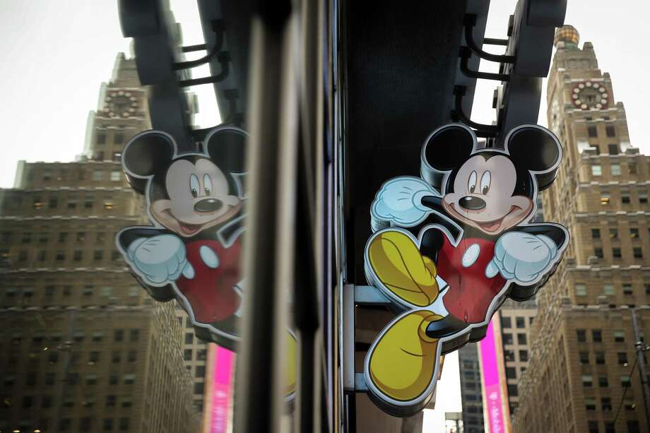 An image of Mickey Mouse, the official mascot of The Walt Disney Company, is displayed outside the Disney Store in Times Square, December 14, 2017 in New York City. The Walt Disney Company announced on Thursday morning that it had reached a deal to purchase most of the assets of 21st Century Fox. The deal has a total value of around $66 billion, with Disney assuming $13.7 billion of Fox's net debt. Photo: Drew Angerer /Getty Images / 2017 Getty Images