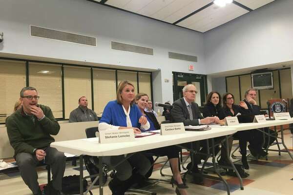 North Ave. resident Stefanie Lemcke spoke in opposition to the current design of the approved North Ave. water tanks, which Aquarion plans to begin construction on in Spring of 2018. Photo taken at the public meeting at Staples High School on Dec. 13.