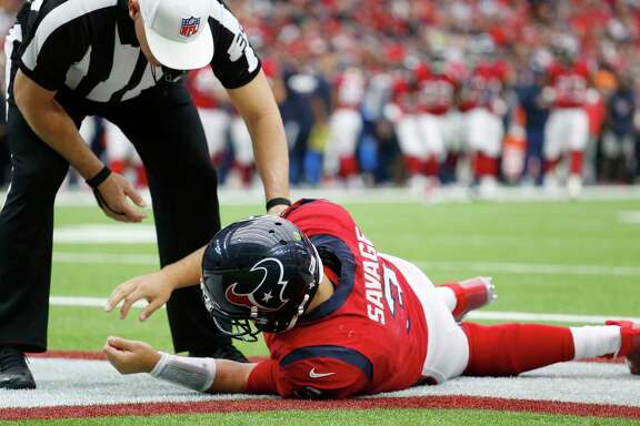 Referee John Hussey checks on Houston Texans quarterback Tom Savage following a hard hit during the second quarter of an NFL football game against the San Francisco 49ers on Sunday, Dec. 10, 2017 at NRG Stadium in Houston. The 49ers defeated the Texans 26-16. (AP Photo/The Galveston County Daily News, Kevin M. Cox)