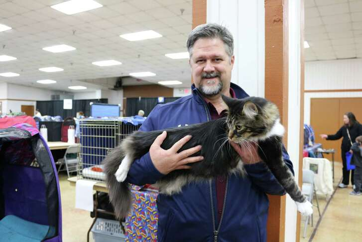 Deer Park Mayor Jerry Mouton finds himself with a king-sized cat at the 2016 Feline Paw Foundation cat show. The event is returning to the city Jan. 26-28.