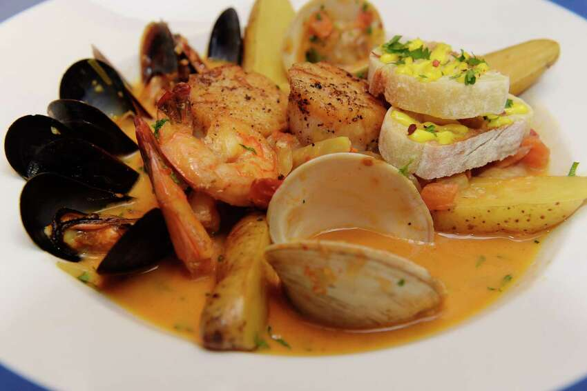 Bouillabaisse de Provence, a seafood stew with shrimp, mussels, clams, scallops, monkfish and potatoes in a saffron-fennel-pernod broth at Provence restaurant at Stuyvesant Plaza on Monday, Dec. 11, 2017, in Guilderland, N.Y. (Paul Buckowski / Times Union)