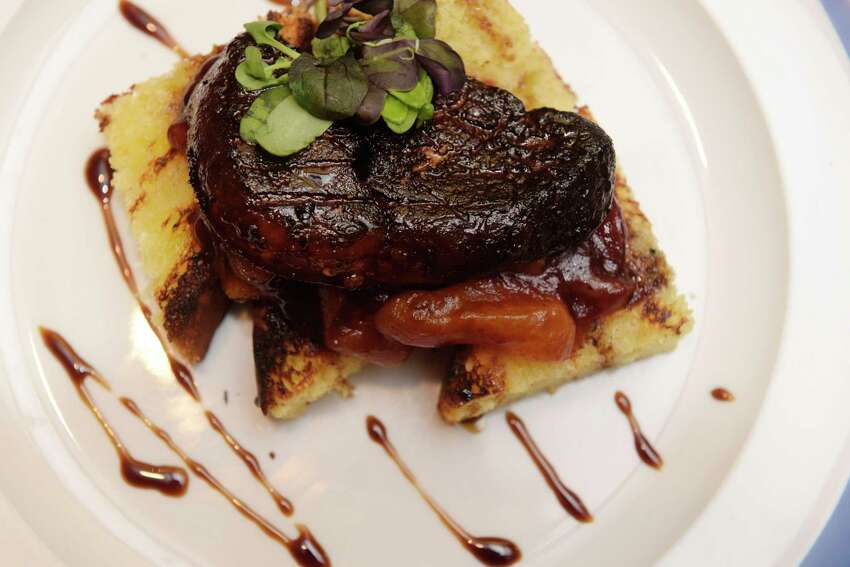 Foie Gras, with a apricot and cranberry compote and a pomegranate glaze at Provence restaurant at Stuyvesant Plaza on Monday, Dec. 11, 2017, in Guilderland, N.Y. (Paul Buckowski / Times Union)