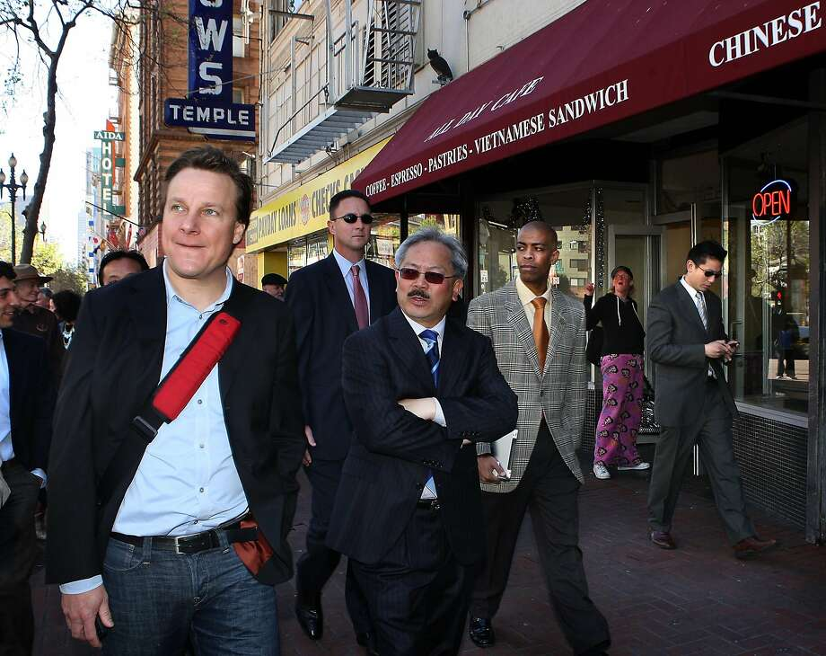 Sean Garrett (left) of Twitter, is given a tour of the central Market Street area with Mayor Ed Lee in 2011. Photo: Liz Hafalia, The Chronicle