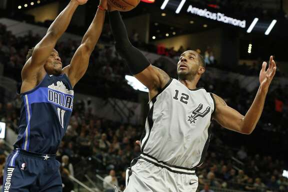 Dallas MavericksÕ Yogi Ferrell and San Antonio Spurs' LaMarcus Aldridge grab for a rebound during first half action Monday Nov. 27, 2017 at the AT&T Center.