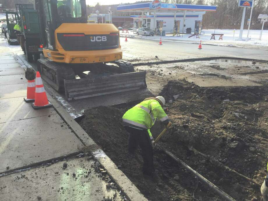 Winsted officials work on a broken water main on South Main Street Thursday. Photo: CONTRIBUTED PHOTO