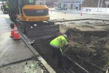 Winsted officials work on a broken water main on South Main Street Thursday.