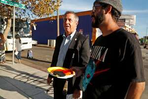 Covered California Executive Director Peter Lee looks at the work of muralist Max Martilla on East Oakland Youth Development Center before the work is unveiled in Oakland, Calif., on Tuesday, November 7, 2017.