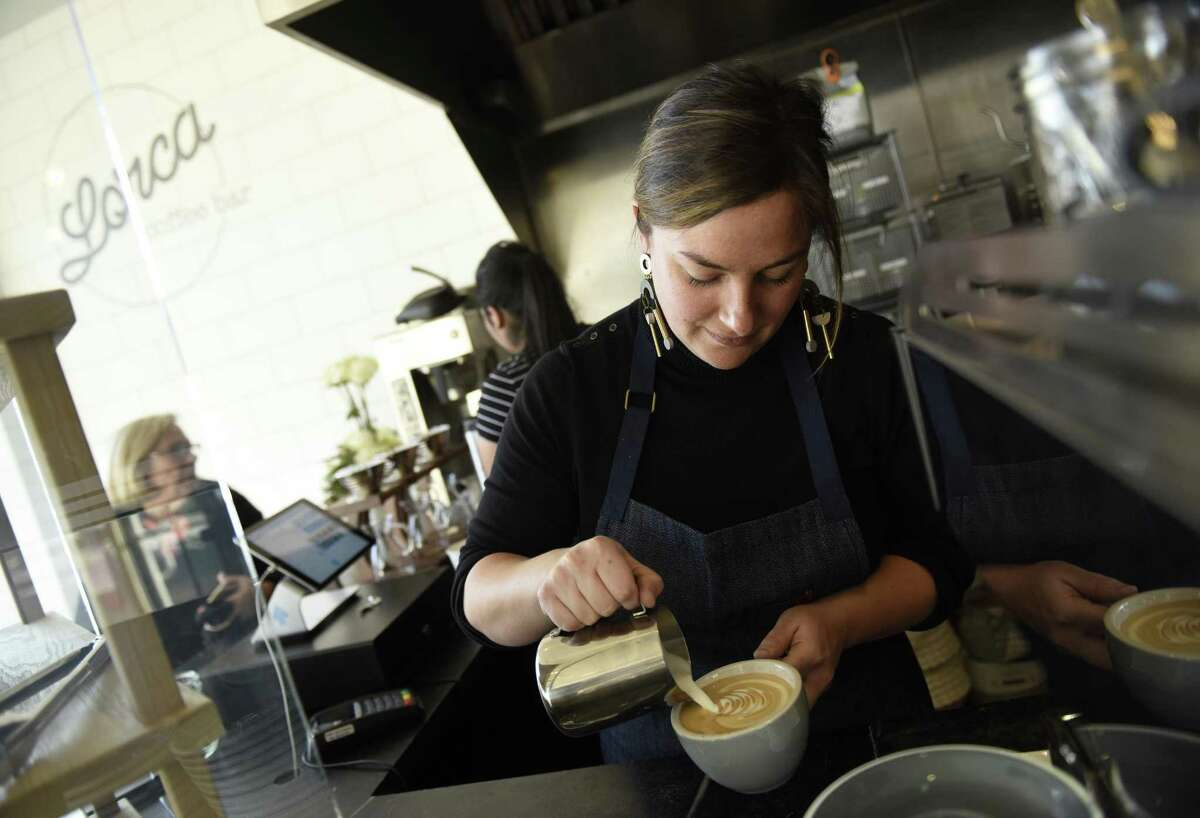 Owner Leyla Dam Jenkins makes a vanilla latte at Lorca, inside Fleisher's Craft Butchery, in Greenwich on Thursday.