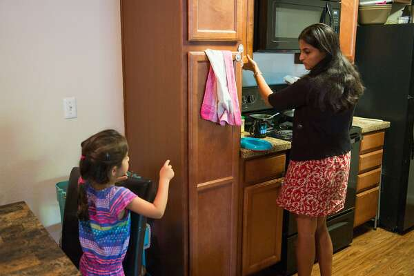 Karishma Chawla prepares a snack for her daughter Naisha at her home in San Jose, Calif. on Friday, Aug. 18, 2017. For decades spouses of H-1B visa holders could not work, until two years ago when President Obama issued a work authorization. But now his authorization is under threat by the Trump administration who is trying to rid these visa holders from the ability to work.