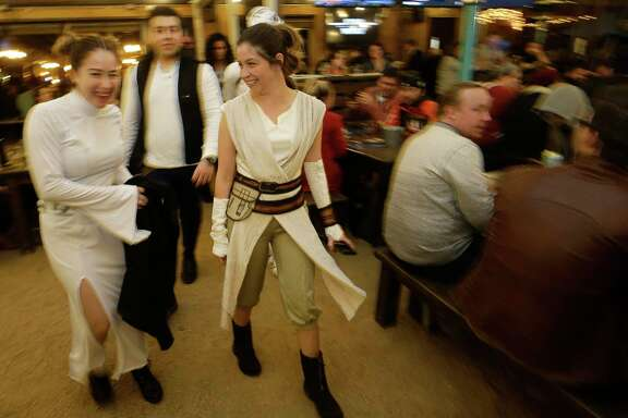 Perla Lopez, left, dressed as Princess Leia, Arturo Salazar, center, dressed as Hans Solo, and Amber Monroe, right, dressed as Rey attend the Star Wars trivia contest at King's BierHaus, 2044 E. T.C. Jester, Wednesday, Dec. 13, 2017, in Houston. ( Melissa Phillip / Houston Chronicle )