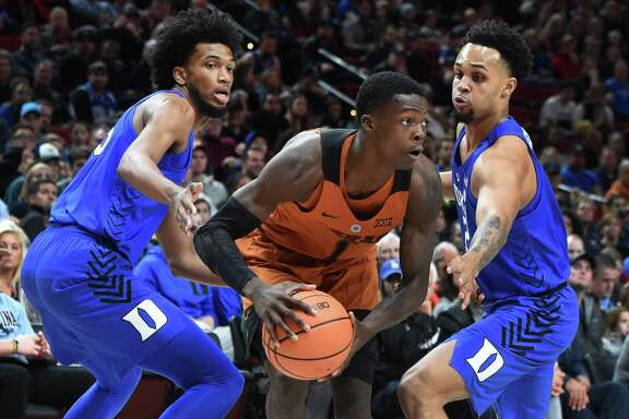 PORTLAND, OR - NOVEMBER 24: Marvin Bagley III #35 and Gary Trent Jr #2 of the Duke Blue Devils trap Andrew Jones #1 of the Texas Longhorns during the first half of the game during the PK80-Phil Knight Invitational presented by State Farm at the Moda Center on November 24, 2017 in Portland, Oregon. Duke won the game 85-78. (Photo by Steve Dykes/Getty Images)