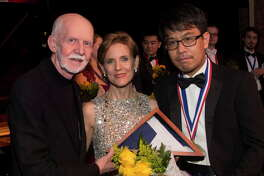 Jim and Susie Pokorski, founder, and chair and executive director of Young Texas Artists Inc., respectively, with Grand Prize winner violinist Douglas Kwon, who took home Gold in the Strings division.