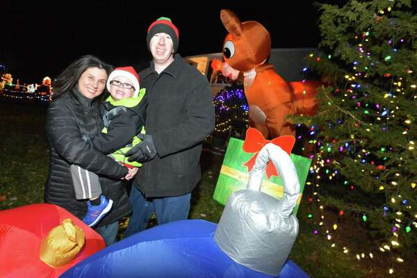 The Kovatch family, Richard, Tina and 5-year-old Matthew, in the front yard they have decorated for the holidays with giant inflatable figures, handmade signs, thousands of lights and Christmas decorations all over their Norwalk home.