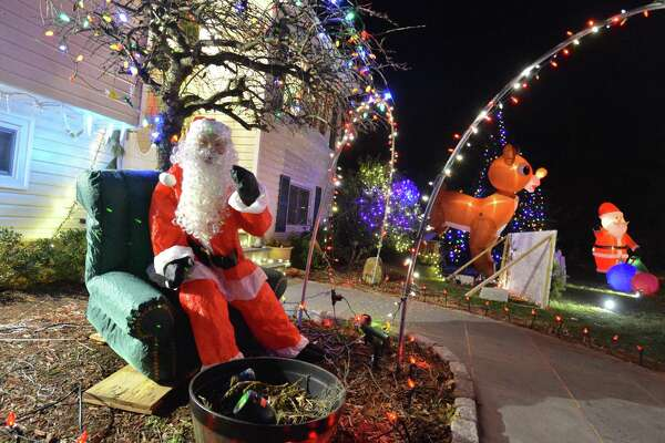 Holiday decorations are in full swing outside at the Kovatch family house after they have decorated for the holidays with giant inflatable figures, hand made signs, thousands of lights and Christmas decorations all over the front of their Norwalk Conn. house on Wednesday December 13, 2017