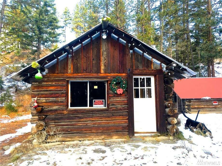This cabin in Liberty near Cle Elum at 601 Harkness Rd. is listed for $145,000.The little cabin is 481 square feet and sits on 2½ acres. Photo: Photos And Listing Courtesy Of Mary Ann Adams, Keller Williams Realty Bellevue