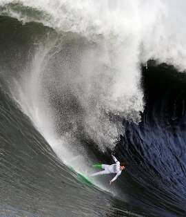 Nic Lamb begins to fall off his board during the third heat of the first round of the Mavericks Invitational big wave surf contest Friday, Jan. 24, 2014, in Half Moon Bay, Calif. (AP Photo/Eric Risberg)