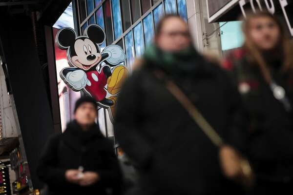 NEW YORK, NY - DECEMBER 14: An image of Mickey Mouse, the official mascot of The Walt Disney Company, is displayed outside the Disney Store in Times Square, December 14, 2017 in New York City. The Walt Disney Company announced on Thursday morning that it had reached a deal to purchase most of the assets of 21st Century Fox. The deal has a total value of around $66 billion, with Disney assuming $13.7 billion of Fox's net debt. (Photo by Drew Angerer/Getty Images)