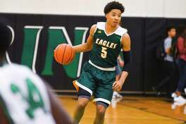 Durey Cadwell led Klein Forest (7-3) with 21 points as the Eagles escaped Spring with a 78-74 pre-district win Tuesday night at Spring High School.