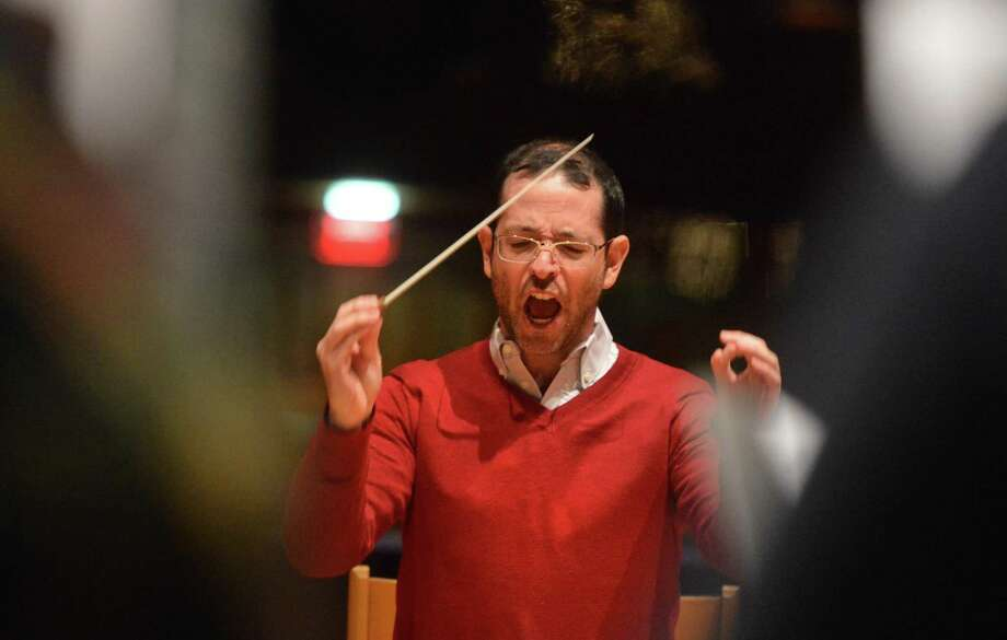 The Norwalk Symphony Orchestra Music Director Jonathan Yates goes over a piece by Bach with the Mendelssohn Choir of Connecticut during rehearsal at St. Lukes's Church in Westport Conn. on Tuesday December 12, 2017 for their upcoming concert Joys of the Season: Bach to Pops at The Norwalk Concert Hall Photo: Alex Von Kleydorff / Hearst Connecticut Media / Norwalk Hour