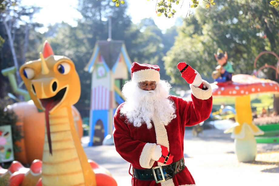 Eric Martin, Fairyland's Santa Claus, poses for a portrait next to Happy Dragon at Fairyland  on Thursday, December 14, 2017 in Oakland, Calif. Photo: Lea Suzuki, The Chronicle