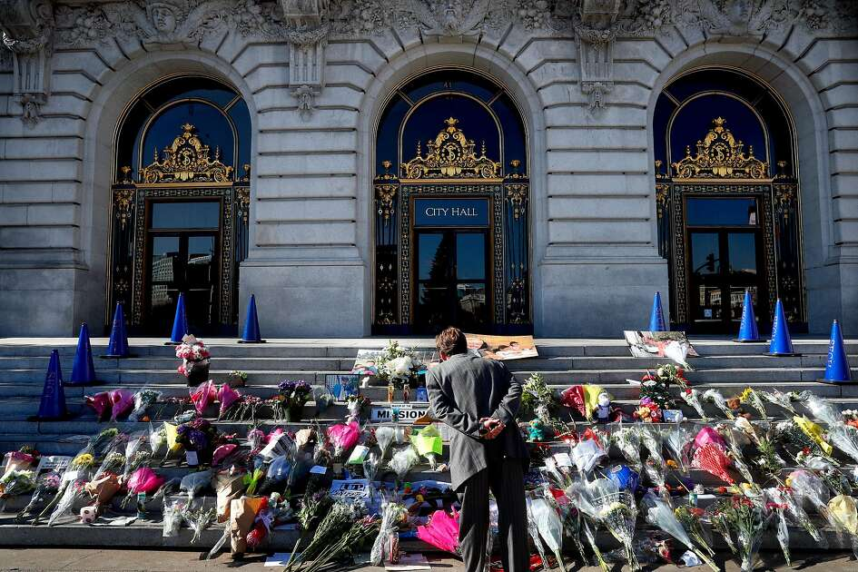 People stop to observe the memorial to Mayor Ed Lee which continues to grow in size after his death in front of City Hall, as seen on Thursday December 14, 2017, in San Francisco, Calif. The City of San Francisco prepares for Mayor Ed Lee To Lie In State At City Hall on Friday Dec. 16th.