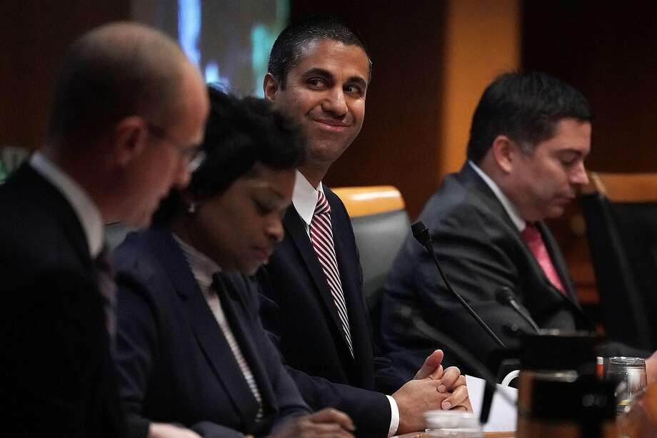 Federal Communications Commission Chairman Ajit Pai (3rd L) smiles during a commission meeting Dec. 14 in Washington, D.C. FCC has voted to repeal its net neutrality rules at the meeting. Photo: Alex Wong, Getty Images