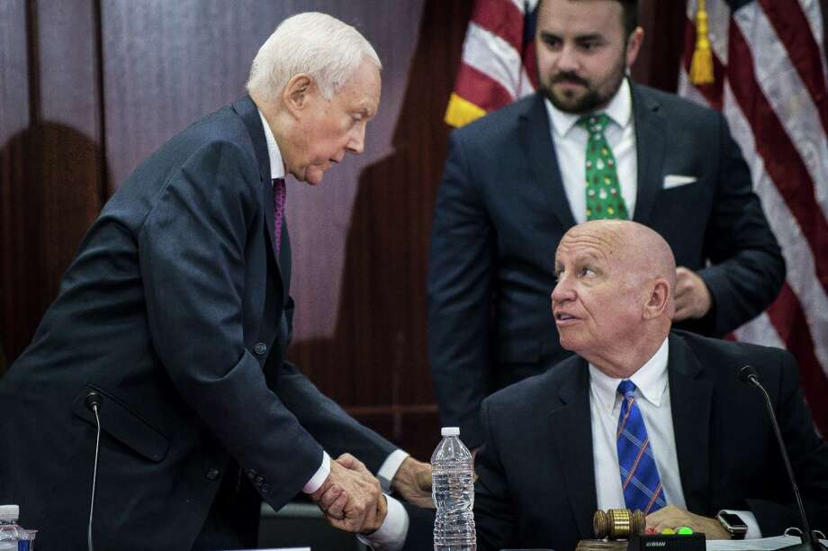 From left, Sen. Orrin Hatch of Utah) and Rep. Kevin Brady of Texas shake hands at a meeting of the conference committee merging the House and Senate tax bills, on Capitol Hill Wednesday. The rush in reaching an agreement is likely about trying to notch up a win on the theory that voters will respect that — despite what's in the bill. Photo: PETE MAROVICH /NYT / NYTNS