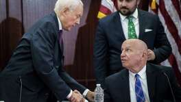 From left, Sen. Orrin Hatch of Utah) and Rep. Kevin Brady of Texas shake hands at a meeting of the conference committee merging the House and Senate tax bills, on Capitol Hill Wednesday. The rush in reaching an agreement is likely about trying to notch up a win on the theory that voters will respect that — despite what's in the bill.