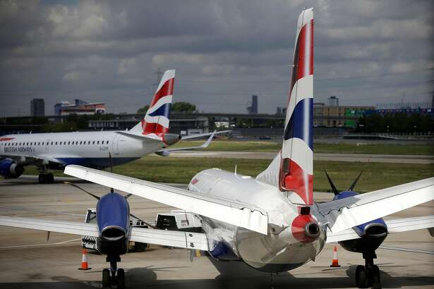 British Airways passenger aircraft, operated by IAG SA, prepare for flights on the tarmac at London City Airport Ltd. in London, U.K., on Wednesday, Aug. 6, 2014. London City Airport, where a short runway has prevented operations with long-haul planes, said it's in talks about flights to the Middle East, Turkey and Russia as new jets bring more distant destinations within reach. Photographer: Matthew Lloyd/Bloomberg