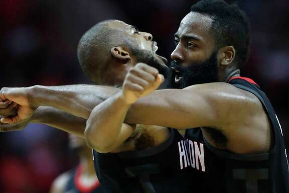 Houston Rockets guards James Harden (13) and Chris Paul (3) celebrate together after one of Harden's three-pointers during the second half of an NBA game at Toyota Center, Monday, Dec. 11, 2017, in Houston. Rockets won 130-123.   ( Karen Warren / Houston Chronicle )