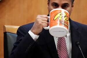 WASHINGTON, DC - DECEMBER 14:  Federal Communications Commission Chairman Ajit Pai drinks from a big coffee cup during a commission meeting December 14, 2017 in Washington, DC. The FCC is scheduled to vote on a proposal to repeal net-neutrality.  (Photo by Alex Wong/Getty Images)