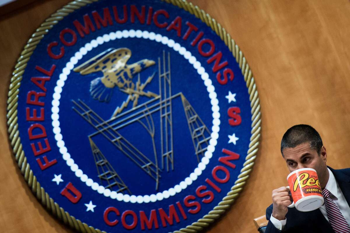 FCC Chairman Ajit Pai listens during a hearing at the Federal Communications Commission on December 14, 2017 in Washington, DC. / AFP PHOTO / Brendan Smialowski (Photo credit should read BRENDAN SMIALOWSKI/AFP/Getty Images)