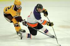 Stamford/Westhill senior Cooper Healy (4) finished with 48 points last season.
