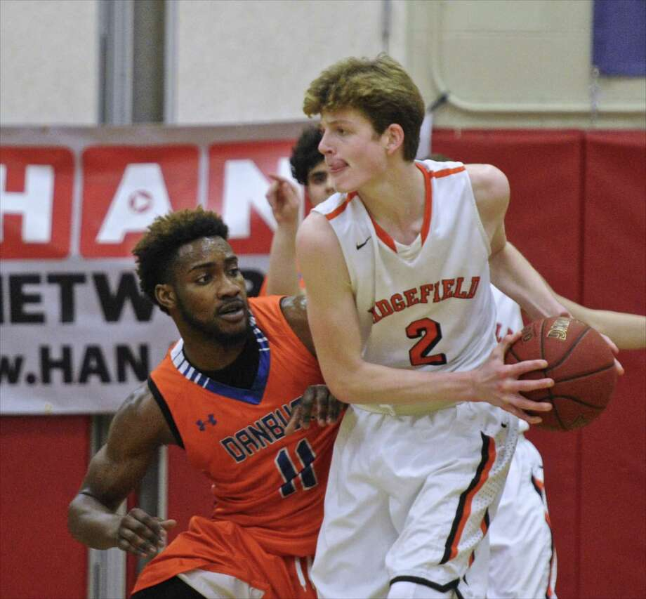Ridgefield's Brenden McNamara drives against Danbury last season. Photo: H John Voorhees III / Hearst Connecticut Media / The News-Times