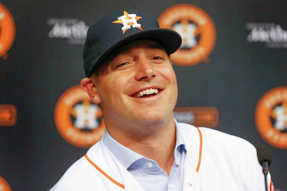 Reliever Joe Smith was all smiles Thursday at Minute Maid Park after signing a two-year deal to pitch for the Astros. He struck out 11.8 batters per nine innings for the Indians last season. Photo: Steve Gonzales, Houston Chronicle / © 2017 Houston Chronicle