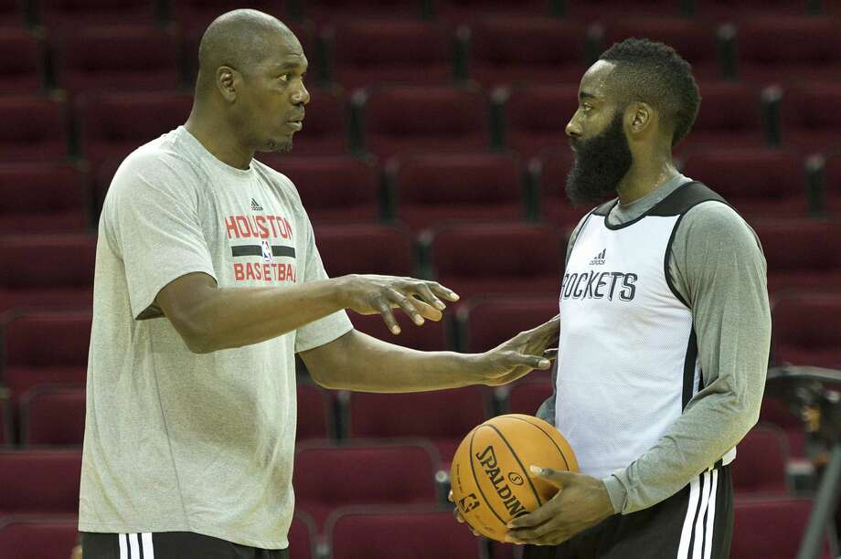 Hakeem Olajuwon works works with Houston Rockets shooting guard James Harden during the first practice of the team's preseason training camp at Toyota Center on Saturday, Sept. 28, 2013, in Houston. ( Smiley N. Pool / Houston Chronicle ) Photo: Smiley N. Pool, Staff / Houston Chronicle / © 2013  Houston Chronicle