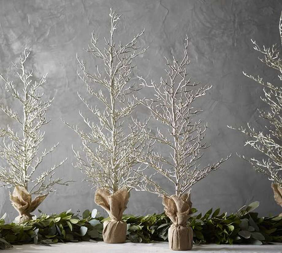 Snowy NightsChampagne Glitter Trees, from $29.50Bring the delight of a snowy evening into your home this holiday season with these glittery champagne-hued trees. Available in small or large, these burlap-wrapped trees are a great addition to your mantel or tabletop. Photo: Courtesy Of Pottery Barn