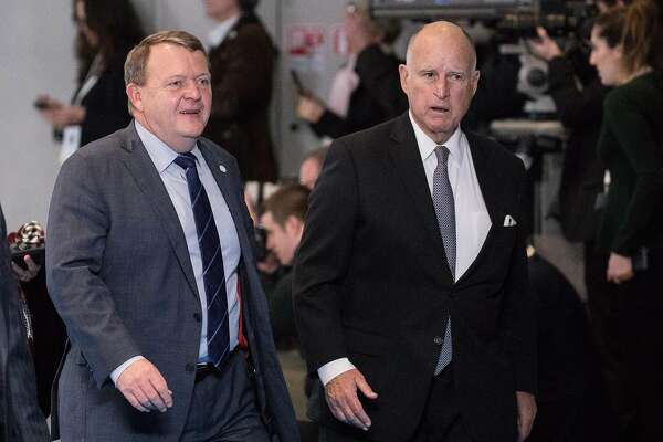 Lars Lokke Rasmussen, Denmark's prime minister, left, and Jerry Brown, governor of California, arrive at the One Planet Summit in Paris, France, on Tuesday, Dec. 12, 2017. French President Emmanuel Macron hosts at least four world leaders, three mayors and the governor of California at an event in Paris on Tuesday aimed at breathing life into the global fight against climate change. Photographer: Christophe Morin/Bloomberg