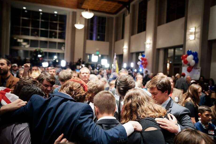 Supporters of Roy Moore, the Republican candidate for U.S. Senate, pray Tuesday at an election night gathering in Montgomery, Ala. Moore lost amid accusations of misogyny and assaults on teenage girls. Photo: AUDRA MELTON, NYT