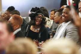 "Jacqueline Belcher laughs with other church members during a 16th Street Baptist church service, Sunday, Dec. 10, 2017, in Birmingham, Ala. At the church pastor Arthur Price told the mostly black congregation that Alabama's U.S. Senate election is too important to skip. ""There's too much at stake for us to stay home,"" Price said of Tuesday's election. (AP Photo/Brynn Anderson)"