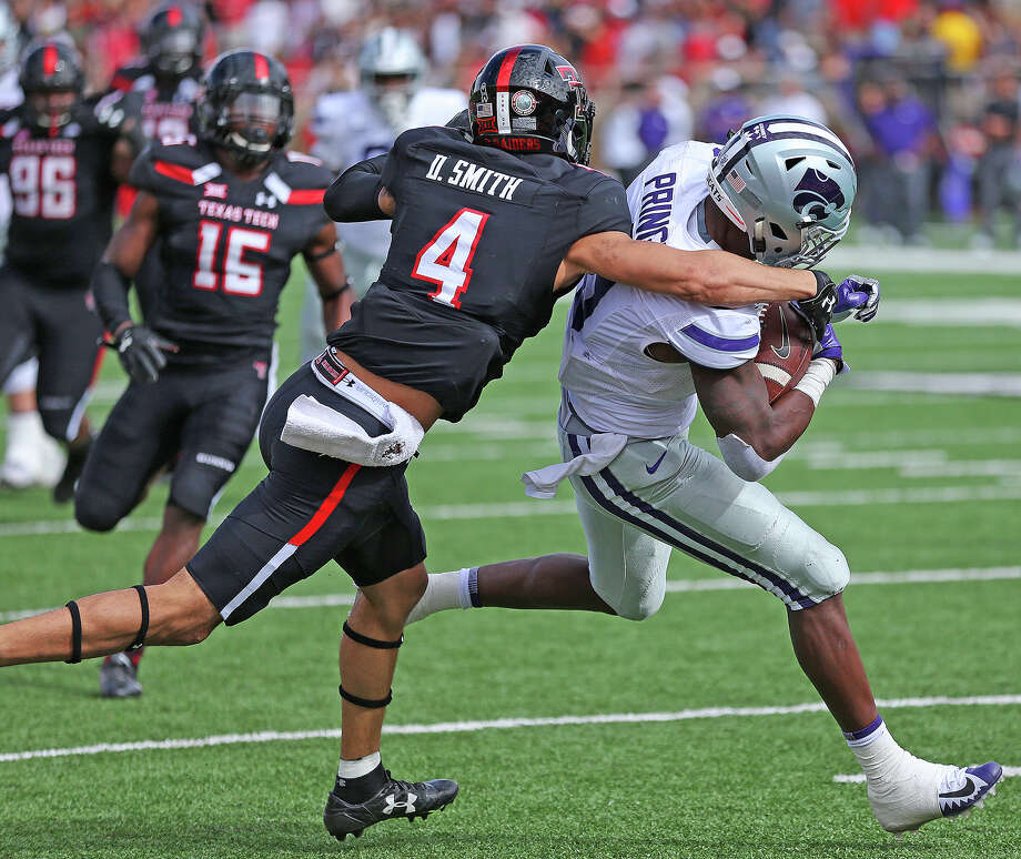 Kansas State wide receiver Byron Pringle (9) hauls in a pass for a touchdown against Texas Tech defensive back Desmon Smith (4) Saturday at Jones AT&T Stadium Photo: Wade H Clay