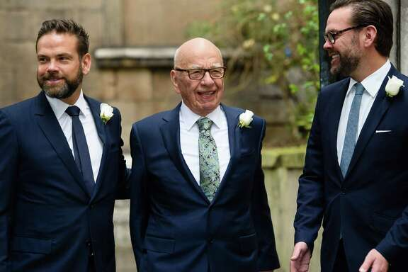 Australian-born media magnate Rupert Murdoch is flanked by his sons Lachlan, left, and James in 2016. The elder Murdoch is moving to sell off wide swaths of his media and entertainment business.