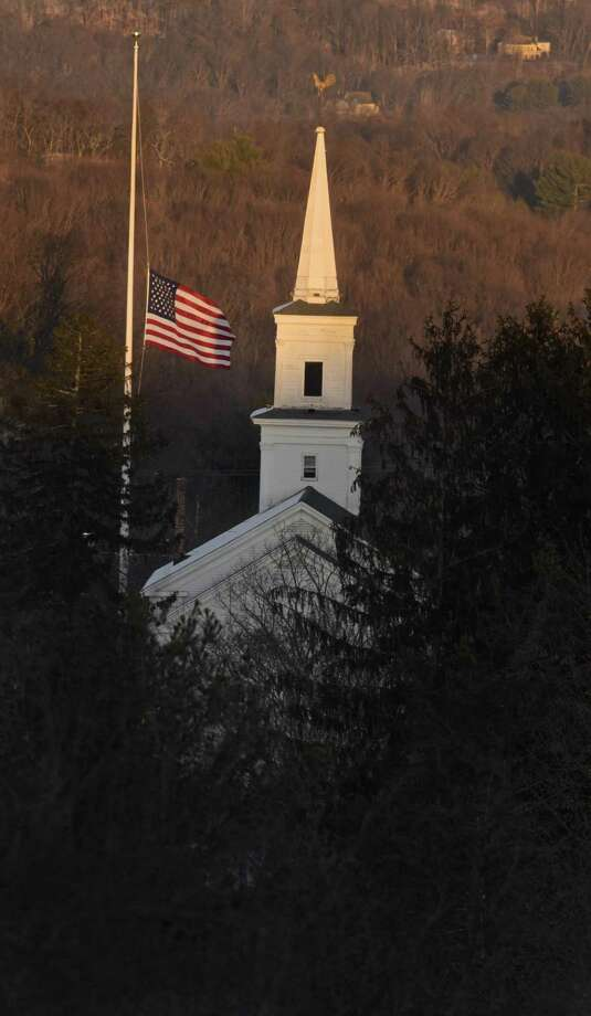 The flag on the Newtown flag pole flies at half-staff, like all others across the state of Connecticut, in memory of the victims of the Sandy Hook Elementary School shooting on Thursday, the fifth anniversary of the shooting. December 14, 2017, in Newtown, Conn. Photo: H John Voorhees III / Hearst Connecticut Media / The News-Times